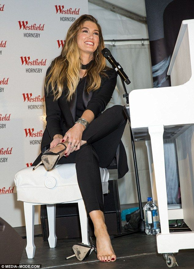 Barefoot beauty! Delta Goodrem kicked off her heels before playing new single Dear Life at an in-store appearance at Westfield Hornsby in Sydney over the weekend