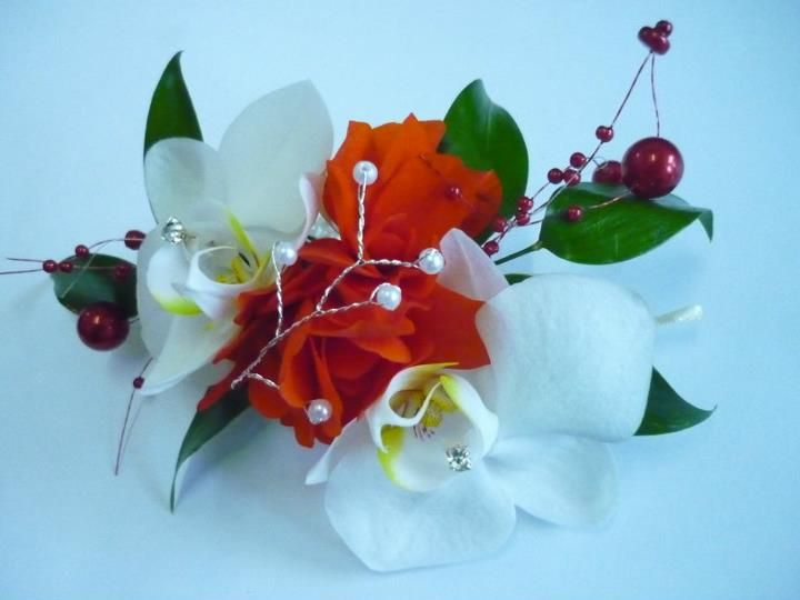 Our white Orchid with hint of yellow ladys's corsage for possibly a lovely orange dress