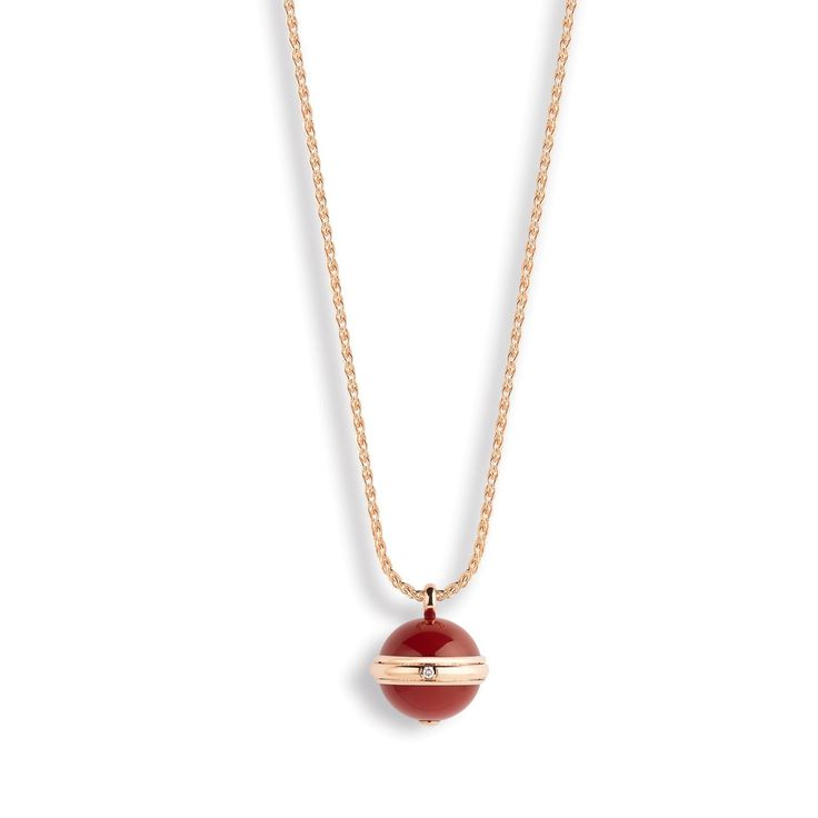 Piaget Posession red carnelian pendant-style necklace in yellow gold with a single diamond. http://www.thejewelleryeditor.com/images/piaget-posession-jewellery/ #jewelry