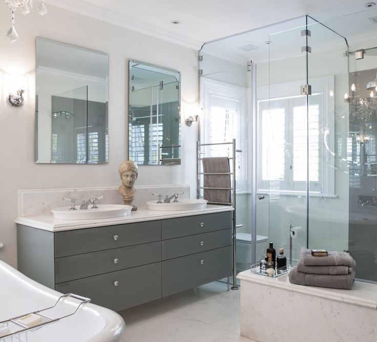 The marble floor tiles work well with the modern touch of glass.