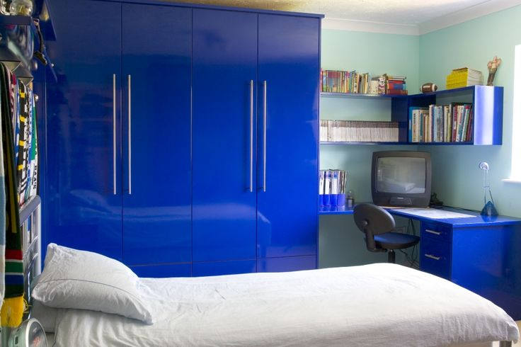 Bespoke wardrobe, shelving and desk space - perfect for a child's/teenager's room. By Anthony Mullan furniture.