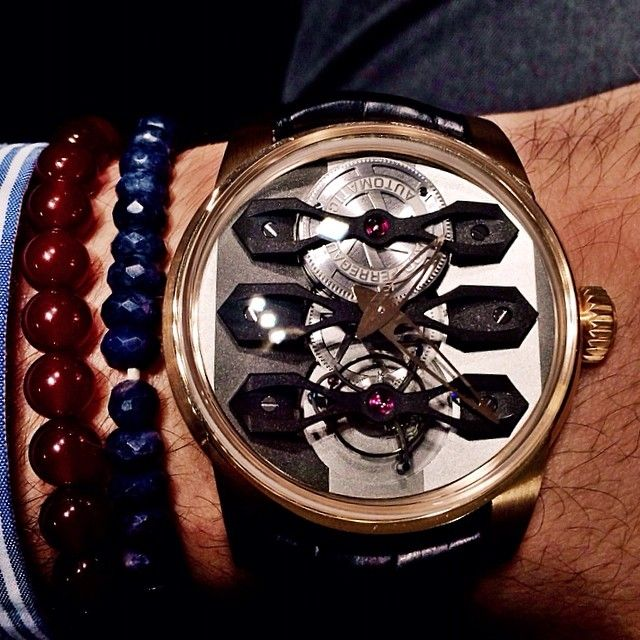 Girard-Perregaux Neo-Tourbillion with three bridges..made of 245 components and carrying an in-house movement with 72 hour power reserve...One of the most glorious timepieces ever made..