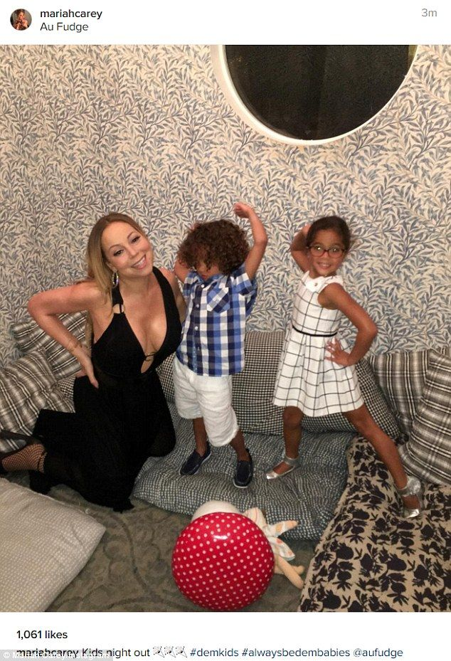'Kids night out': Mariah Carey enjoyed some bonding with herfive-year-old twins: son Morroccan and daughter Monroe as she shared this picture on Instagram on Sunday