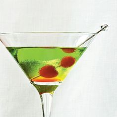 Happy Elf    The colors of this drink are fun and festive, but it's the flavor that will have you asking for a refill. Melon liqueur is mixed with citrus vodka and a touch of cranberry juice for a surprisingly subtle and refreshing green cocktail. Serve in a martini glass and garnish with maraschino cherries to present a lovely combination of red and green.