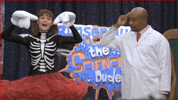 S.6, Ep. 4 Brennan dressed as the Bone Lady for the Professor Bunsen Jude (the Science Dude) show
