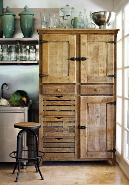 Rustic Kitchen cupboard >> Stunning piece, love the stool too. The glass and ceramics are also beautiful!!