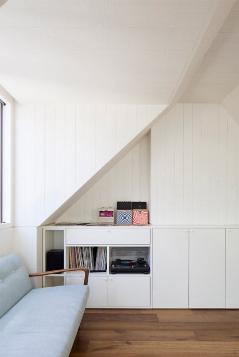 "Hampstead loft conversion by Alexander Martin features ""a new twist on the hidden library door""."