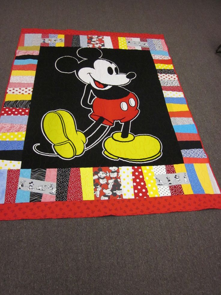 I made this reversible Mickey Mouse  quilt from a shower curtain cover, old sheets, t-shirts & quilting cotton.