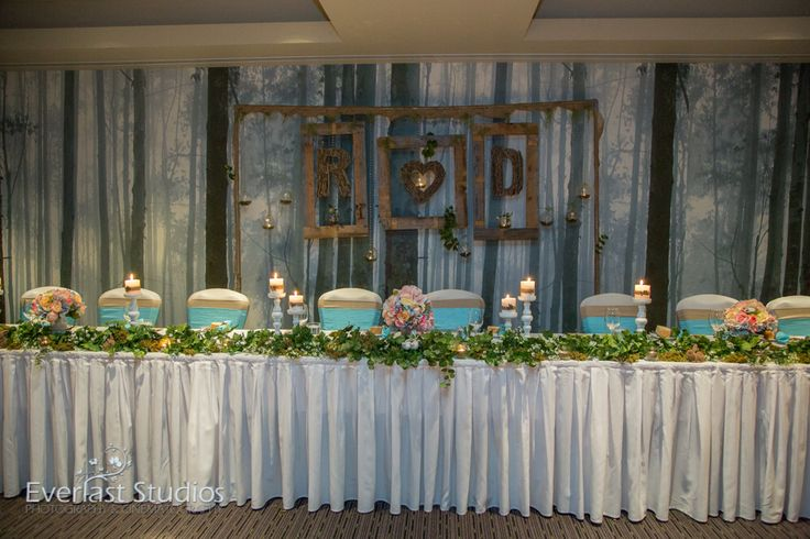 Unique personalised wedding backdrop. Timber and twig backdrop with couples initials. Hanging  rustic frames