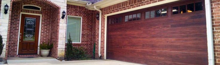 I have never seen a garage door quite like this. I think it's the color that is so unique. The red is such a perfect choice for a brick house like that!