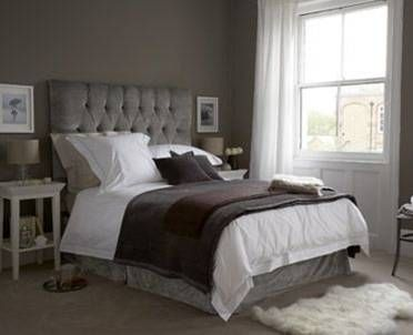 the grey tufted headboard paired with calming whites keeps this bedroom very serene. love that there are so many textures of fabric - adds a rich layering to the room.