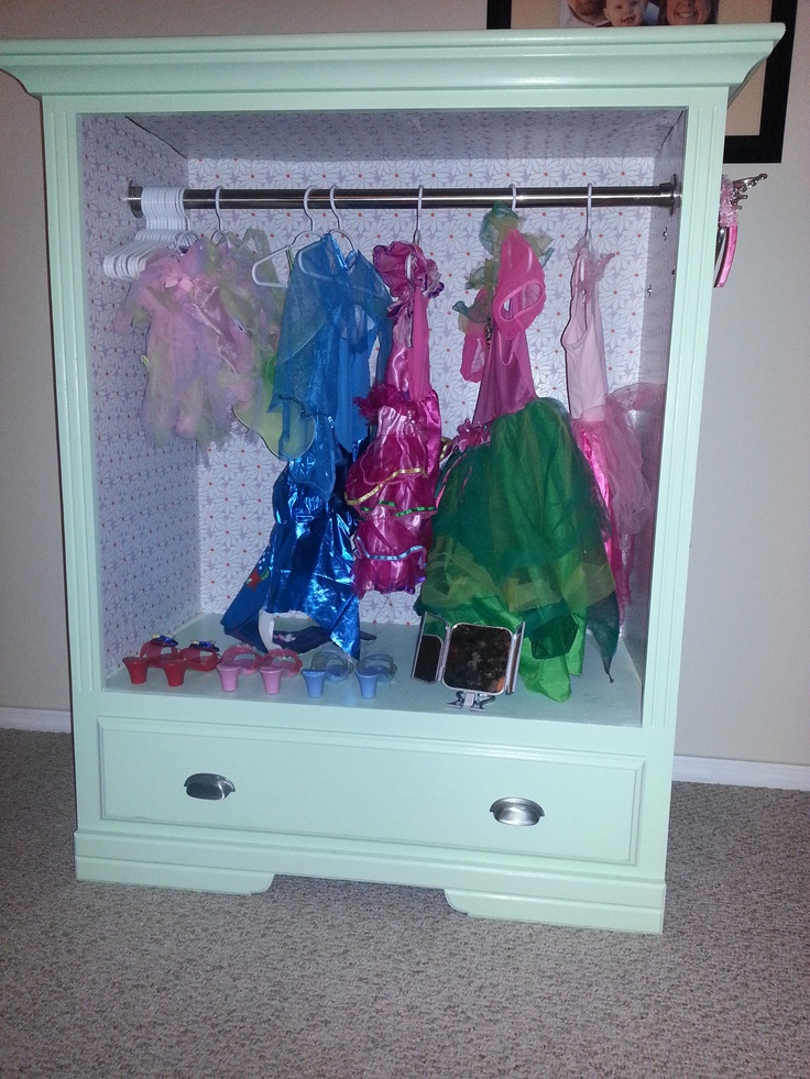 Make it from an old dresser!  Spray paint and attach a rod.  Perfect!