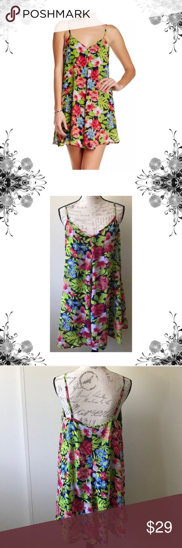 "NWOT Mimi Chica Tropical Floral Print Shift Dress Micro Mini Floral Print Shift Dress. 100% Polyester. Approx 34"" in length. V-neck. Adjustable spaghetti straps. Allover print. Lined. Bundle for discounts! Thank you for shopping my closet! Bin 12/33 Mimi Chica Dresses Mini"