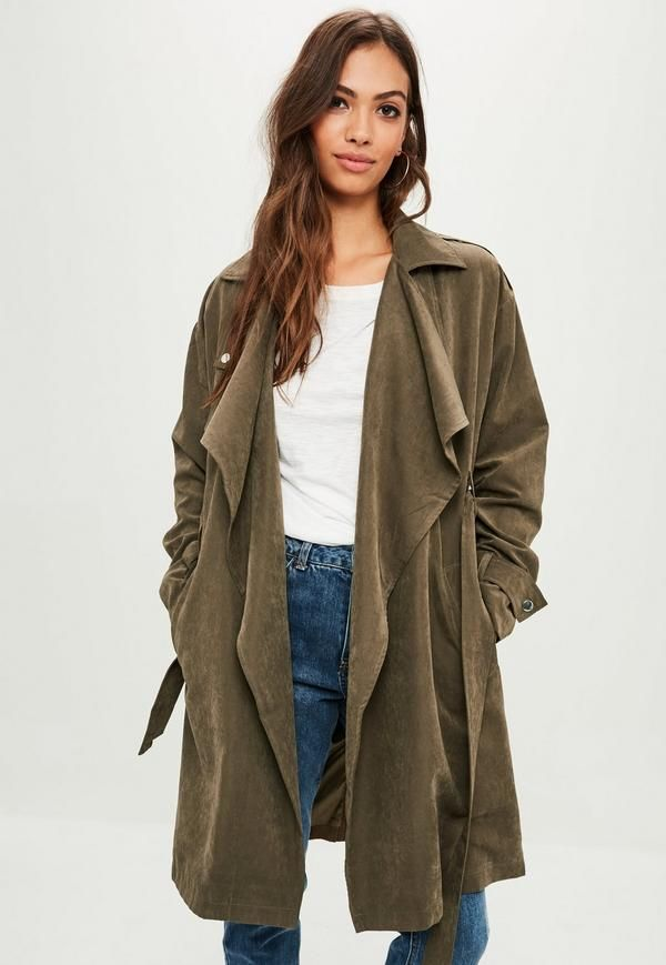 This trench coat features a beige hue, contrasting d ring detail, flared sleeves and a longline style.