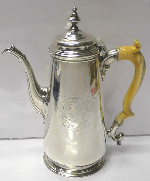 George II Silver Coffee Pot  A plain style antique sterling silver coffee pot with large engraved coat of arms to the front. Repinned by www.silver-and-grey.com