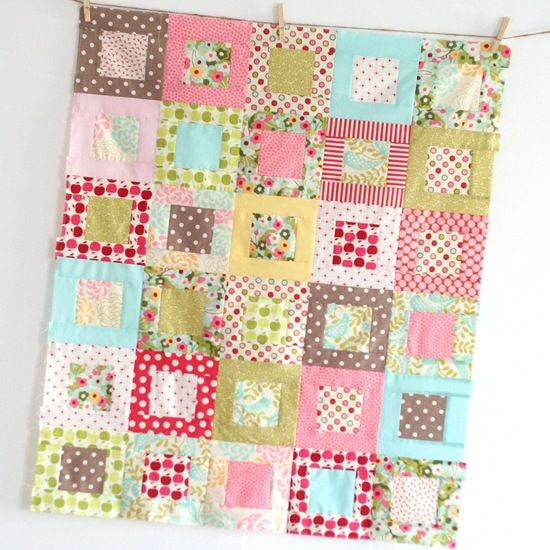 "Square in a square baby quilt. Cut 4"" middle, 2""x4"" sides, 2""x7"" top/bottom"