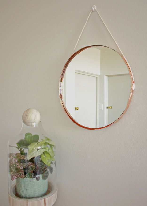 Edge a simple round mirror in copper tape. | 33 Gorgeous DIY Projects To Decorate Your Grown Up Apartment