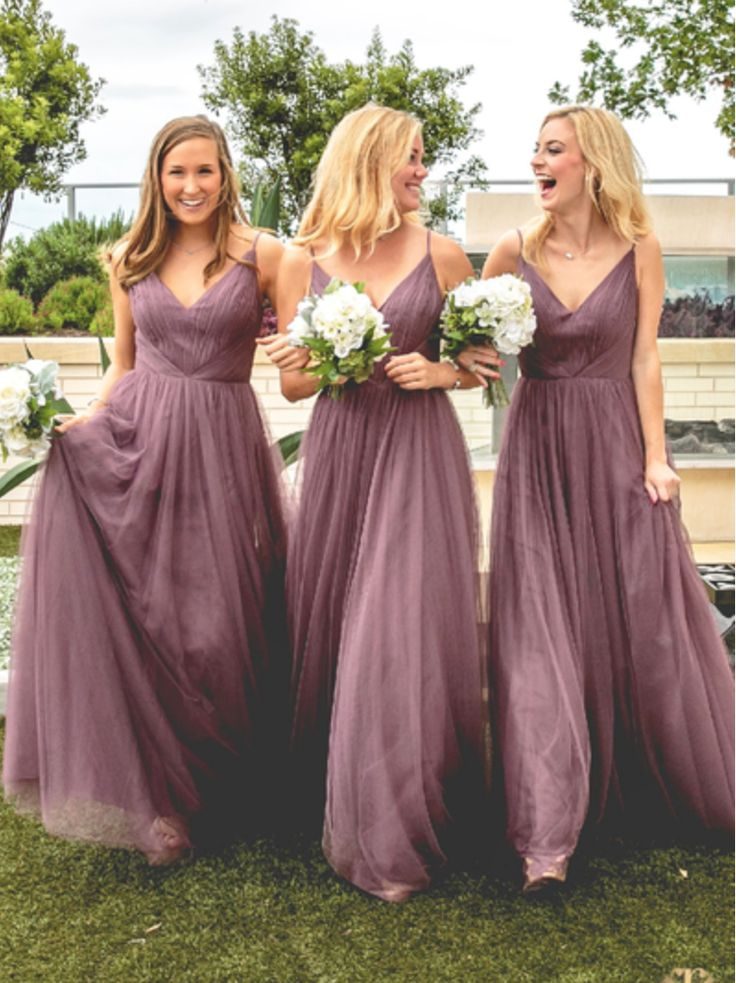 Fall in love with this ballerina inspired bridesmaid dress crafted with the softest, lightest tulle. The shirred bodice, v-neck, and natural waistline flatters all body types. Accessorize with a jeweled belt for some extra sparkle. http://wedding.shoprevelry.com/Revelry-bridesmaid-dress-tulle-penelope-maxi-dress/