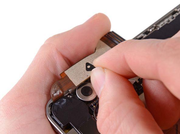 8. Fjern det lille sorte afstandsstykke, som var under Phillips-skruen tæt på vibratoren.