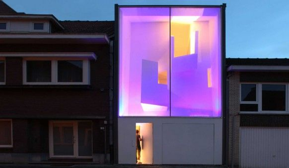 Glass Facade Reveals Architecturally Sculpted Home