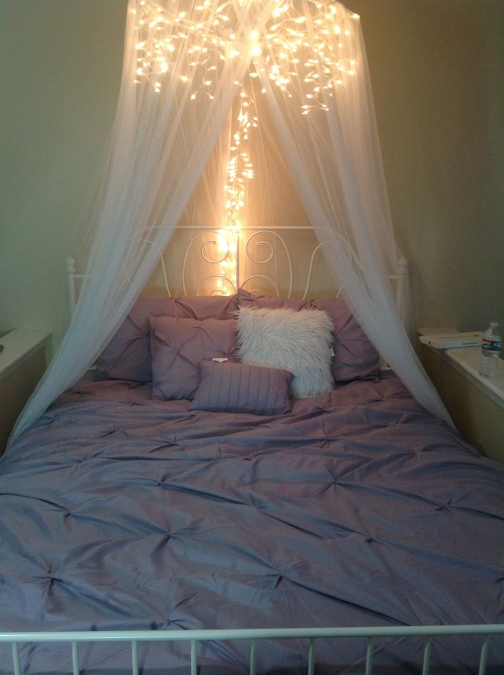 DIY Bed Canopy.  Icicle lights and a $10 canopy from craigslist!