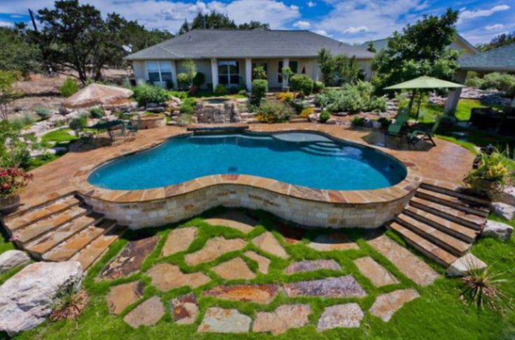 in-ground/above-ground pool on a slope