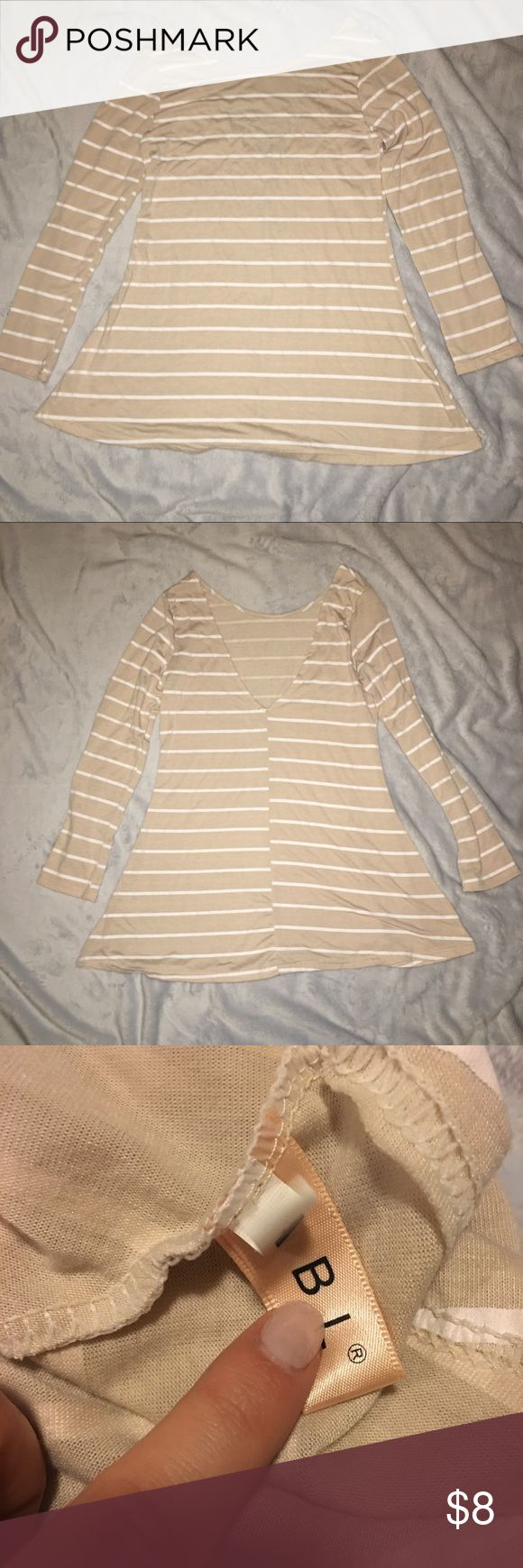 Tan and White stripe Tunic Size small tan and white striped tunic. the neckline on this tunic is very wide you would probably have to wear a strapless bra because you will definitely see the straps of your bra with this tunic. Low back. Got this tunic off of SHEIN wore once but just didn't like that I needed to wear a strapless bra. Tops Tunics