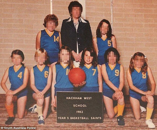 Adelaide schoolgirl Louise Bell pictured holding a ball with her school basketball team. Pfennig's daughter also played basketball with Louise