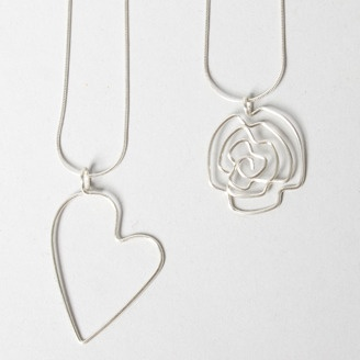 Sterling silver heart and flower necklaces by Kari Woo - Canmore, AB. Member of the Alberta Craft Council.