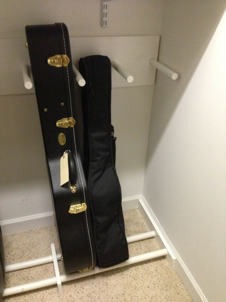 How to organize Steve's 20 guitars... i could make this with a shoe rack, pool noodles, and a cheap coat rack! guitar case storage in closet