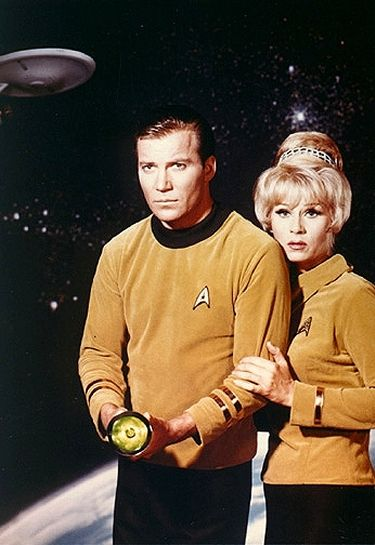 Early Star Trek publicity shots featuring William Shatner as Captain Kirk and Grace Lee Whitney as Yeoman Janice Rand.