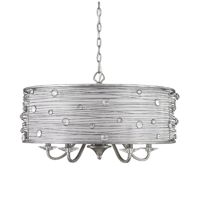 The fascinating design of this 5 Light Chandelier can enhance the splendor of your home. The shade of this chandelier serves to soften and spread light evenly across the room. The glittering crystals on the shade of this chandelier make it look gorgeous. The Peruvian finish of this chandelier is distressed, and enhances the appeal of contemporary- or transitional- interiors. This 5 Light Chandelier has 5 incandescent light bulbs. This chandelier is crafted from high-quality materials, and…