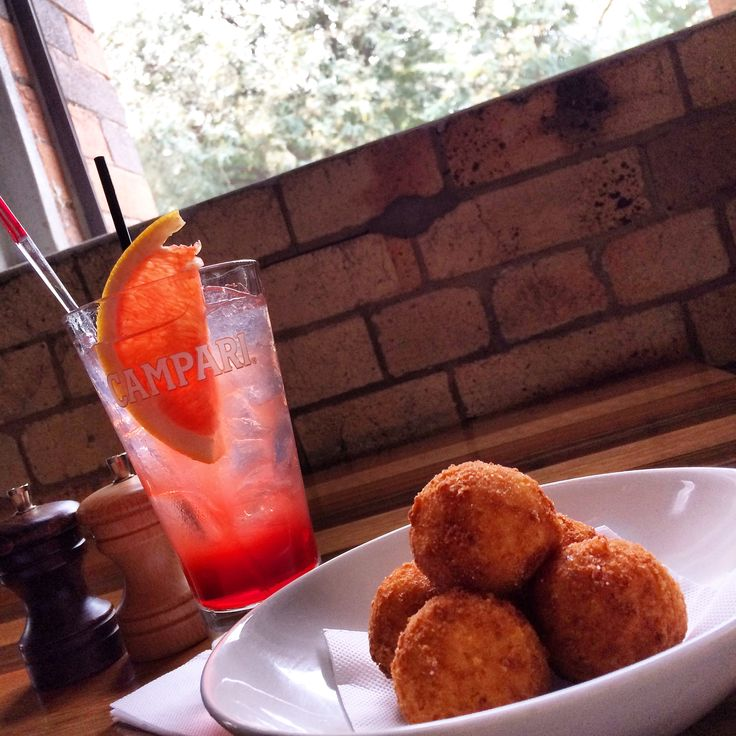 Settling in on a drizzly #friday #afternoon with my two best friends #campari and #arancini