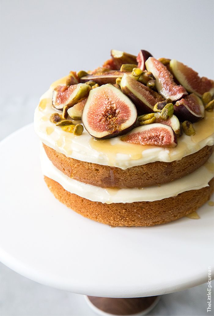 The perfect summer picnic dessert! This fig cake is made with an Earl Grey based cake, frosted with honey cream cheese and topped with fresh figs and toasted pistachios.