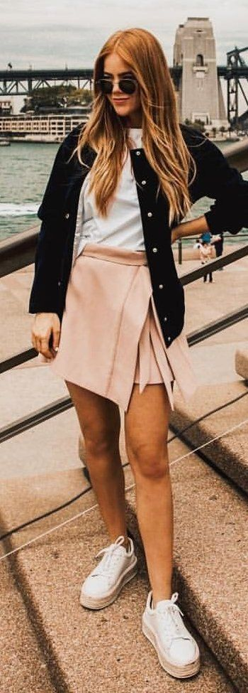 #spring #outfits woman in black button-up jacket and beige mini skirt. Pic by @ootdmagazine