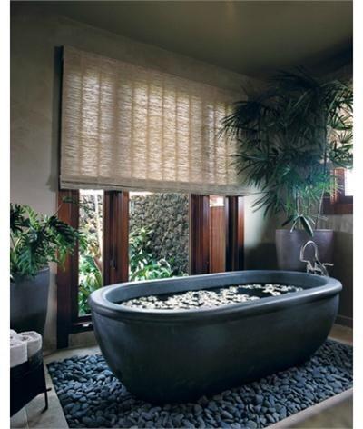 Love the stones surrounding this black bath tub!