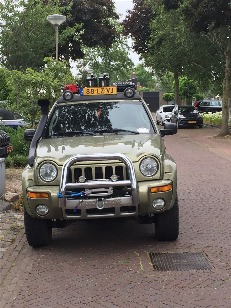 Jeep KJ modified Winch, rock sliders, rack with cans, plates and high lift jack Made by offroadtech Helmond Holland