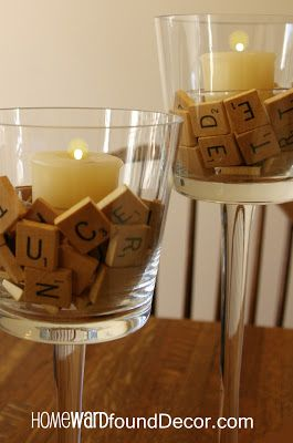 A 'Fast, Cheap & Easy' tabletop candle idea from HOMEWARDfound Decor (votives sit in a smaller glass cup, tucked inside the Scrabble letters)