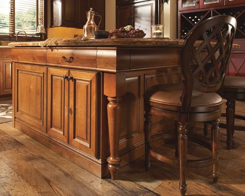 Medallion Wakefield door in Rustic Cherry Harvest Bronze, with turned legs and contoured drawer fronts.