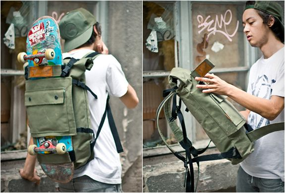 Scumbag is a Roll-top backpack by Blind Chic, it features a front panel that allows for a skateboard or other object to slide in between the panel and the bag.