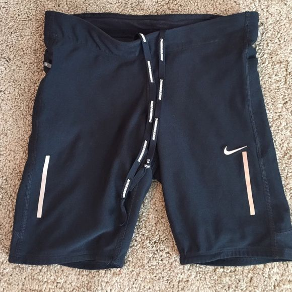 Nike Tech 8 inch shorts The Nike Tech shorts are made with DRI-FIT fabric and a stretch waist for a snug fit. Interior drawstring and side zip pocket and another small pocket in the rear. Reflective elements as well. Great condition! Waist is 25 inches. Nike Shorts