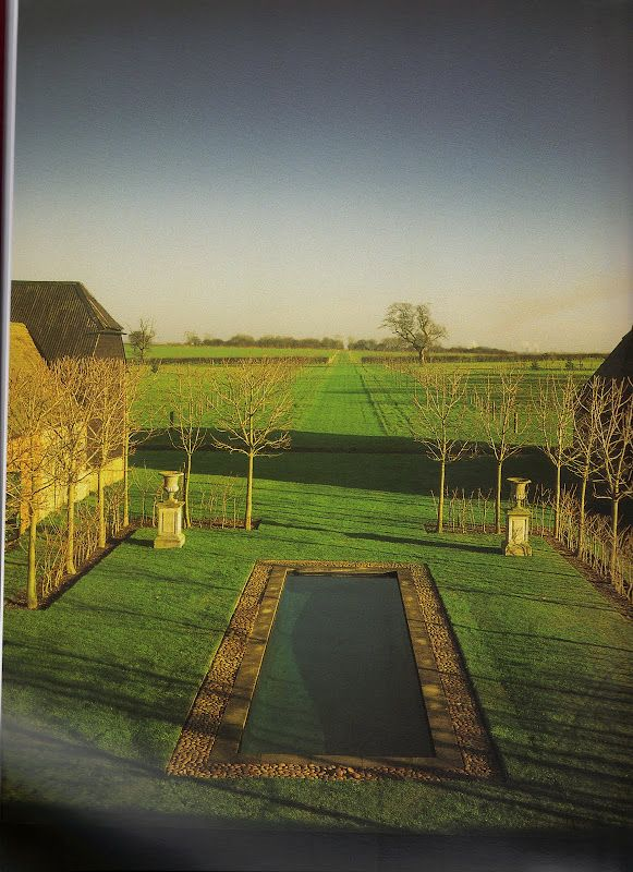 """David Hick's garden """"the grove"""" - pool painted to mimic reflecting pond; pleached trees"""