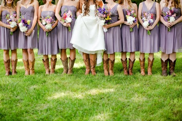 purple bridesmaids dresses + wildflower bouquets + cowboy boots = L O V E / Katelyn James Photography