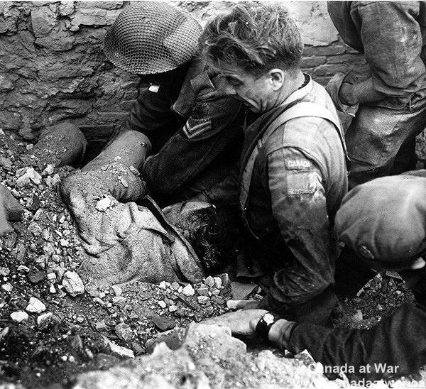 Ortona - Lance Corporal Roy Boyd of The Loyal Edmonton Regiment is rescued after being burried under the rubble of the mined house for three and a half days.
