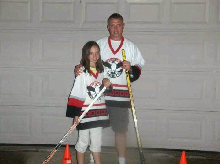 Father and daughter street hockey; she won; by talent and perservance!