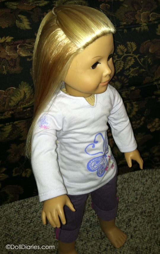 2-3 tbls downy fabric softener, water in spray bottle. Downy Spritz technique to fix frizzy American Girl doll hair ~ must do this!