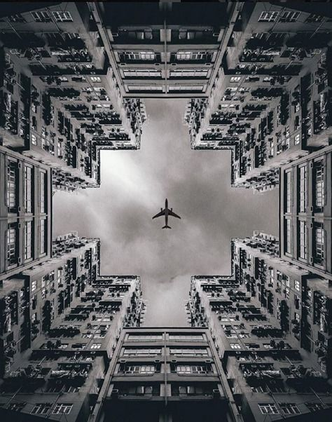 This photograph represents balance due to the symmetry of the buildings and the plane. If the photo were to be split down the middle, it would have a mirror image.
