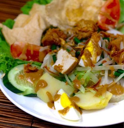Gado-gado is a traditional dish in Indonesian cuisine, and is comprised of a vegetable salad served with a peanut sauce dressing. Althou...