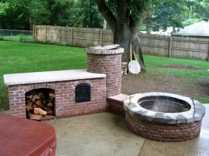 fire pit and smoker. A meat lovers playground! What a great outdoor
