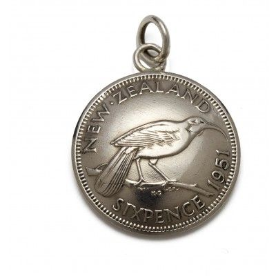 Vintage Coin Charm Sixpence. This charm looks great added to silver charm bracelets or hung on a Stirling silver chain. It is hand crafted from vintage New Zealand currency no longer in circulation. The sixpence is approximately 19mm in diameter and features the now extinct New Zealand Huia bird on the front and King George the Sixth on the back. A great gift or souvenir for the avid traveller, ex-pat Kiwi or teen. Made in New Zealand.  See more at www.entirelynz.co.nz/gifts